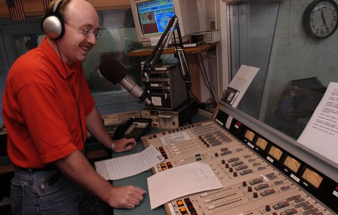 Paul Oates on the air during his radio show at WLVL in Lockport. (Buffalo News file photo)