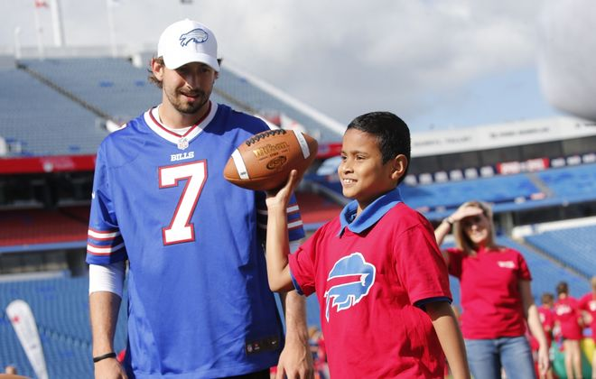 PS79 Grabiarz School of Excellence fourth-grader Amanul Mohammed-Shakil, 9, tests his quarterback skills at an activity station with Bills practice squad quarterback Davis Webb during an event to mark a five-year renewal of the partnership between the Buffalo Bills and Independent Health at New Era Field, Tuesday, Sept. 24, 2019. (Derek Gee/Buffalo News)