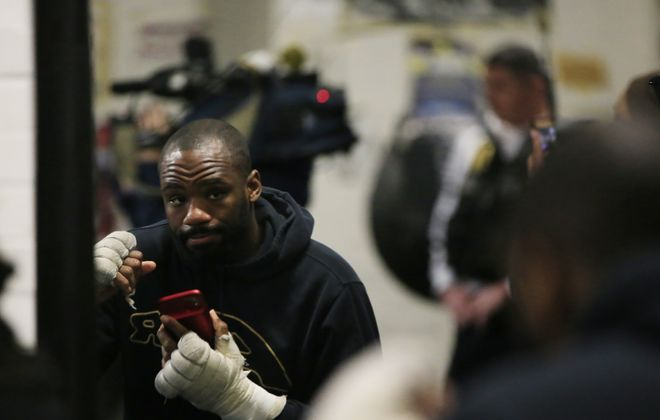 Lionell Thompson shawdow boxes while doing a phone interview during a training session at the Northwest Buffalo Community Center, Tuesday, Jan. 21, 2020. (Harry Scull Jr./Buffalo News)