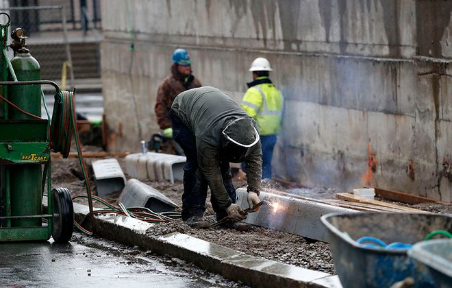 While some construction continued during the shutdown, including outside of Seneca One in Buffalo Monday, other sites will start to reopen Tuesday.   (Mark Mulville/Buffalo News)