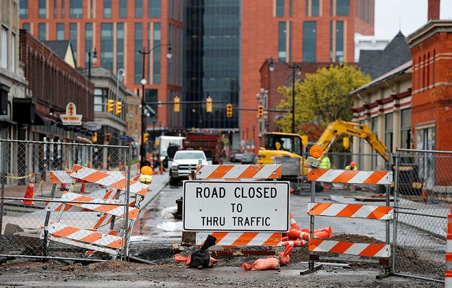 Construction crews work on repairs on Allen Street in Buffalo Monday, May 11, 2020. Construction could be one of the first portions of the local economy to reopen. (Mark Mulville/Buffalo News)
