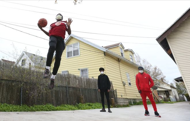 JaVaughn Jones thought he was going to spend his spring and summer playing for the Corey Graham Elite AAU program in hopes of earning a college scholarship. Instead, he is working on his game by playing pickup in his neighborhood with his younger brother Jakai Lofton at their home on LaSalle Avenue. (James P. McCoy/Buffalo News). on Thursday, May 14, 2020. (James P. McCoy/Buffalo News)