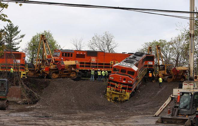 A Buffalo & Pittsburgh Railroad train derailed late Monday along Riley and Main streets in East Aurora. (John Hickey/Buffalo News)