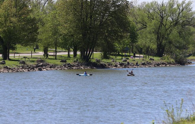 Alex Vrot, left, and Tyler Dent of Appleton kayak on the Erie Canal by Widewaters Marina in Lockport, on Wednesday, May 20, 2020. (John Hickey/Buffalo News)