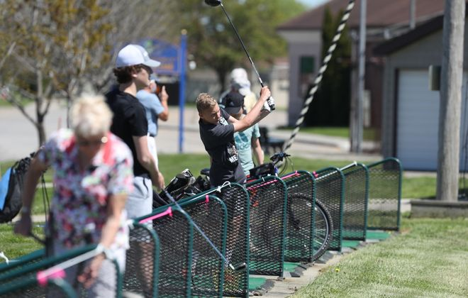 The Town of Tonawanda's Brighton Driving Range reopened Wednesday, May 20, 2020, with social distancing rules in place. Golfers were allowed to tee off as long as they were separated by one full tee box. (James P. McCoy/Buffalo News)