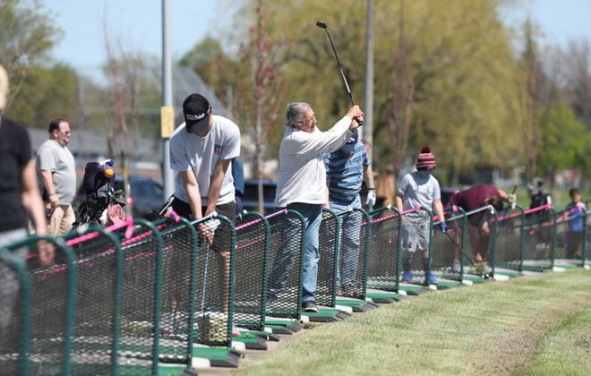 The Town of Tonawanda's Brighton Driving Range reopened  Wednesday with social distancing rules in place. (James P. McCoy/Buffalo News)