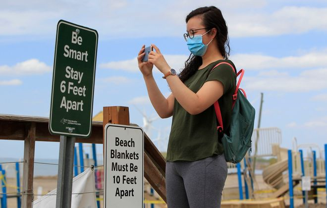 Wendy Huang takes a picture at Woodlawn Beach State Park on Friday, May 22, 2020. (Harry Scull Jr./Buffalo News)