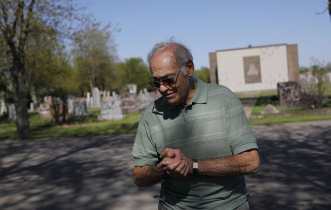 Frank Billittier, who recently recovered from Covid-19, visits the Holy Sepulchre gravesites of family members, including his sister Christina, who died at the age of 2 during the Spanish flu outbreak in 1918. (Derek Gee/Buffalo News)
