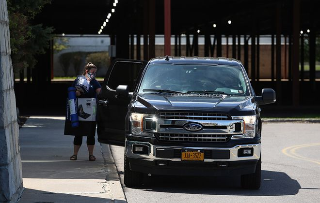 Packages delivered by Dick's employee at curbside pickup at Dick's at the Walden Galleria in Cheektowaga, on Friday, May 22, 2020. (John Hickey/Buffalo News)