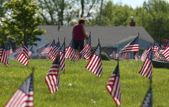 Flags are placed in Mount Calvary Cemetery in Cheektowaga,N.Y. on Sunday, May 24, 2020. (James P. McCoy/Buffalo News)