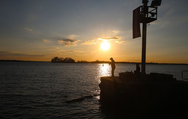 Brandon Ostrowski, left, of Tonawanda fishes the Niagara River off Riverwalk, in Buffalo, on Monday, May 4, 2020. (John Hickey/Buffalo News)