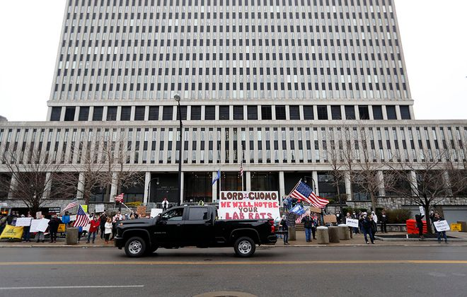 People who would like for New York State to reopen protest in front of the Rath building in Buffalo Friday, May 1, 2020.   (Mark Mulville/Buffalo News)