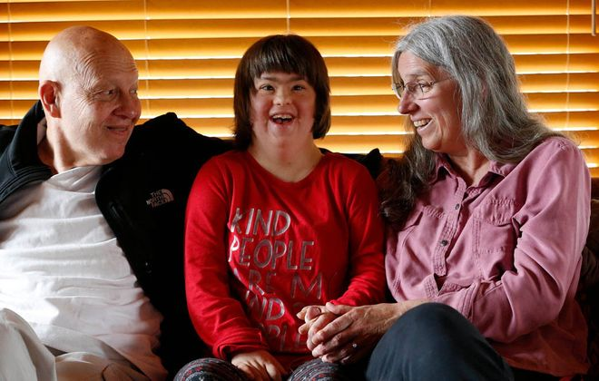 It's all smiles after Emily Janak, center, is officially the adopted daughter of Raymond and Laurette Janak. (Sharon Cantillon/Buffalo News)