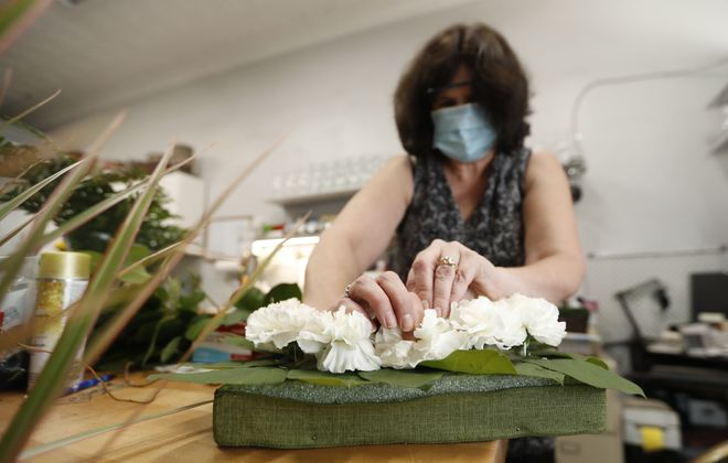Julie Hallgren, owner of North Park Florist makes an icon board for St. George Orthodox Church. (Sharon Cantillon/Buffalo News)