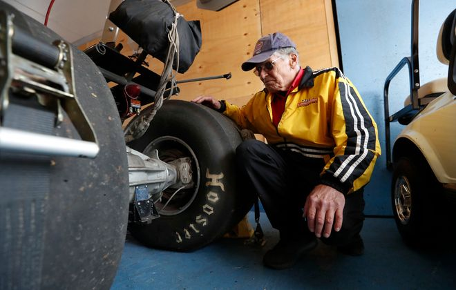 NYIRP inspector Gary Westfall checks a rear engine dragster, owned by Jim Fix, of Amherst. (Sharon Cantillon/Buffalo News)