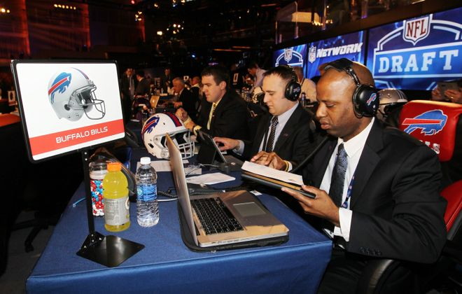 Shone Gipson, right, at the Bills draft table just minutes before the start of the at the 2014 NFL Draft (James P. McCoy/Buffalo News file photo)