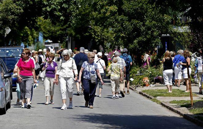 This year's Garden Walk Buffalo will become a virtual garden month. Above, visitors pack  Summer Street during  Buffalo Garden Walk 2014. (Robert Kirkham/News file photo)