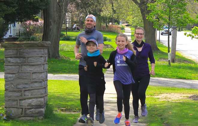 James and Kalista Cozza prepare with their son, Jonah, 8, and daughter, Mia, 10, for the upcoming 10th anniversary Girls on the Run 5K. The event will be run virtually on June 7 with participating families starting and finishing outside their homes. Mom has been a Girls on the Run coach for two years; Mia hoped to participate in the program for a third year before the coronavirus pandemic stopped the afterschool program in its tracks this spring.  (Photo provided by the Cozza family)