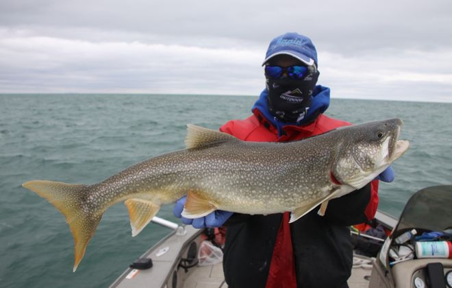 Charter captains are hoping that their businesses can be deemed essential soon because this is prime fishing right now. Capt. Frank Campbell of Lewiston shows off a lake trout from Lake Ontario he caught this week. (Bill Hilts Jr./Buffalo News)