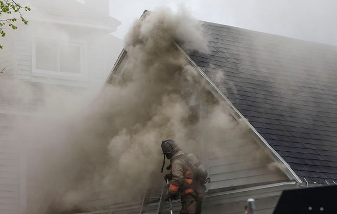 Buffalo firefighters work to contain a blaze in a pair of houses on Garner Avenue near Grant Street, Monday, May 18, 2020. (Derek Gee/Buffalo News)