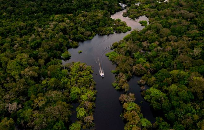 A boat speeds on the Jurura River in the municipality of Carauari, in the heart of the Brazilian Amazon Forest, on March 15, 2020. (Florence Goisnard/AFP via Getty Images)