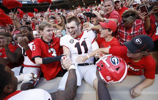 Jake Fromm of Georgia celebrates with fans after a win at Tennessee. (Getty Images)