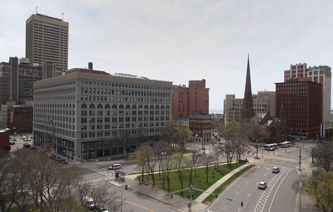 The popular Explore Buffalo Best of Buffalo Downtown tour is one of six self-guided  walking routes touted on its website, explorebuffalo.org. Stops include, from left, the Ellicott Square Building, St. Paul's Episcopal Cathedral and the Guaranty Building. Fun facts about these and other sites can be pulled up on a smartphone or tablet. (John Hickey/Buffalo News)