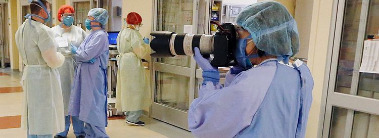 Buffalo News Photographer Sharon  Cantillon suited up to photograph frontline workers at St. Joseph's. (Tim O'Shei/Buffalo News)