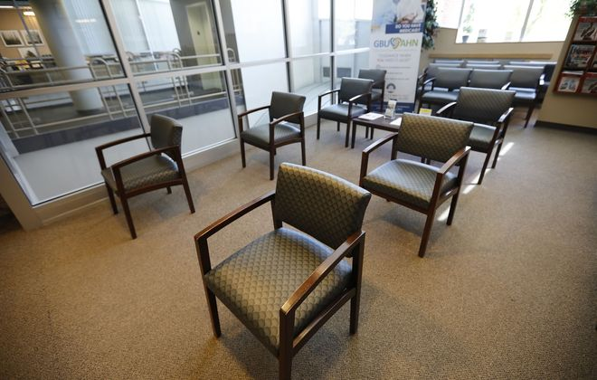 Chairs are separated in the waiting room at the Highgate Medical Group office in West Amherst, where patient volume is down because of the Covid-19 pandemic. (Derek Gee/Buffalo News)
