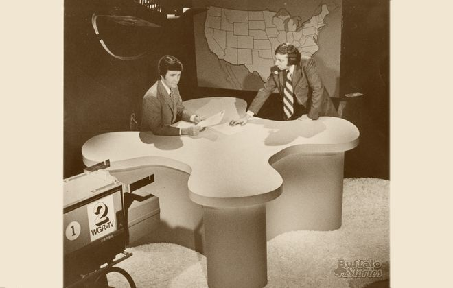 Ron Hunter, talking with director Ernest Ravert.  sitting on his new WGR-TV News set in 1972.