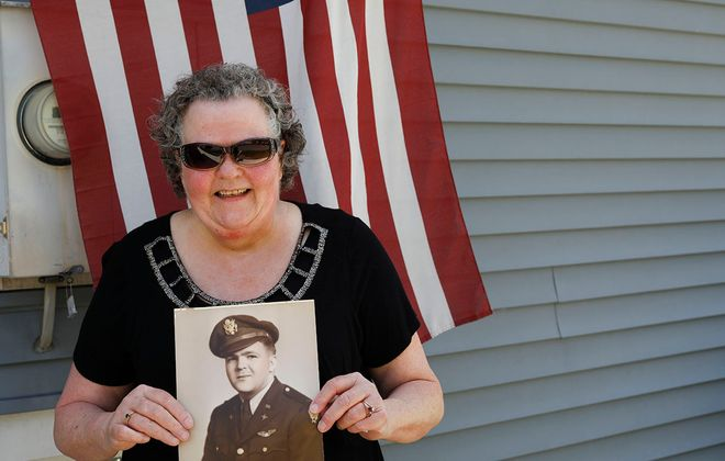 Pat Brumley holds a 1943 photograph of her father, John A. Clark, who was a pilot of a B-32 bomber during WWII, outside her Tonawanda home, Sunday, May 24, 2020. (Derek Gee/Buffalo News)