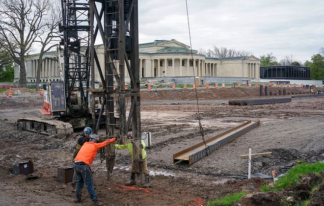 Workers set up equipment while driving steel piles into the ground for the foundation of the new addition at the Albright-Knox Art Gallery which is in the midst of the AK360 campus expansion project, Tuesday, May 19, 2020. (Derek Gee/Buffalo News)