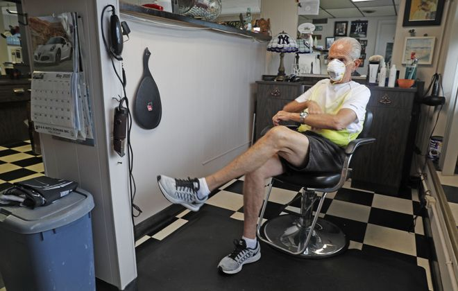 Waiting to reopen. Life-long professional barber Casey Wojtaszczyk, 70, in his Amherst barber shop called Your Head at Eggert Road and Bailey Avenue on Friday, May 29, 2020. (Robert Kirkham/Buffalo News)
