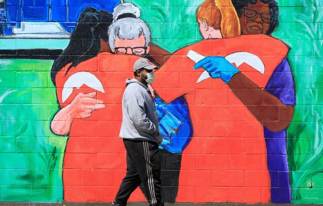 A pedestrian on Kensington Avenue, in Buffalo, amid the pandemic. (Harry Scull Jr./Buffalo News)