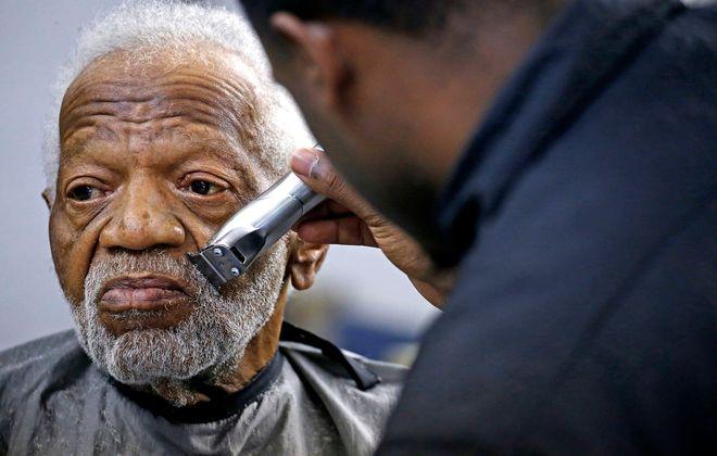 Customer Jacky Coon, 83, visits Carl-Jeff Barbershop on Jefferson Avenue in Buffalo. (Robert Kirkham/News file photo)