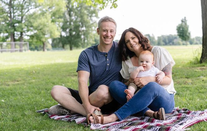 Jolie Tirado Doyle with her husband Matt and their son Flynn. (Image by Meccay Photography)