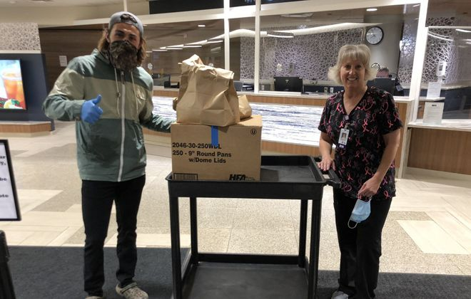 Los Angeles Kings winger Alex Iafallo delivers food to his  mother, Barb, and her coworkers at Buffalo General Medical Center. (Courtesy of Barb Iafallo)