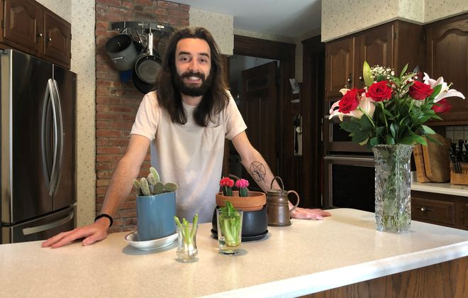 Author Max Kalnitz was already into growing plants  before quarantine, but has been using his extra time to regrow veggies like green onions and lettuce ahead of gardening season.