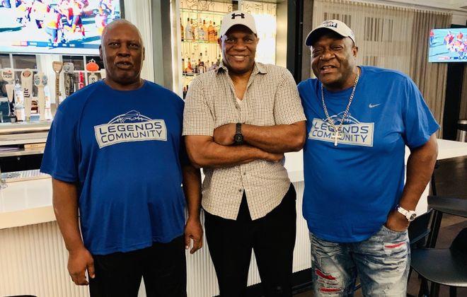 Former Bills defensive end Ben Williams, left, died on Monday. He was 65. He is pictured with former teammates Ken Johnson, center, and Ervin Parker (Courtesy Buffalo Bills)