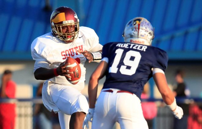 South quarterback Keshone Beal (Cheektowaga High School) runs against the North during the first half of the 44th annual Kensington Lions All-Star football game at Williamsville South High School on Wednesday, July 31, 2019. (Harry Scull Jr./Buffalo News)