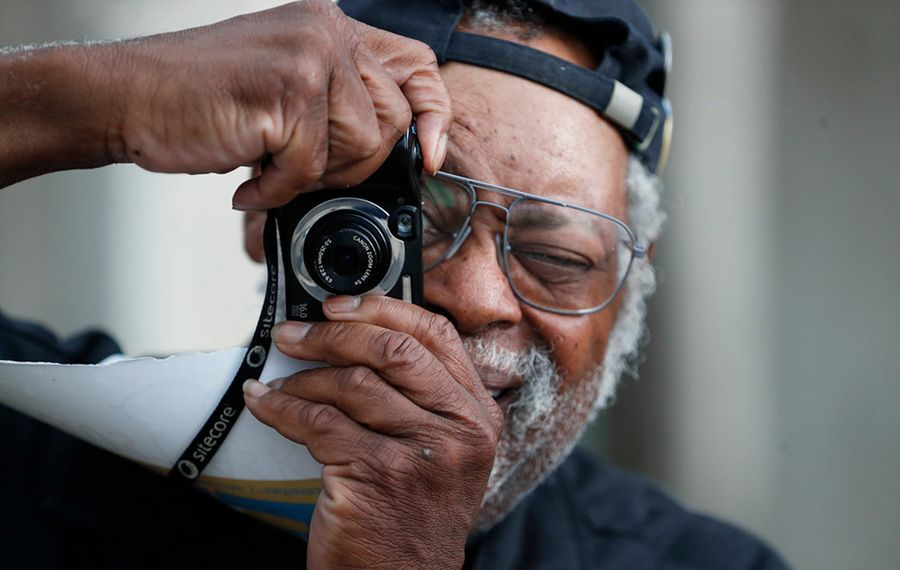 The late photographer and teacher Kenn Morgan was photographed taking pictures at the 2019 Music Is Art Festival. (Sharon Cantillon/News file photo)