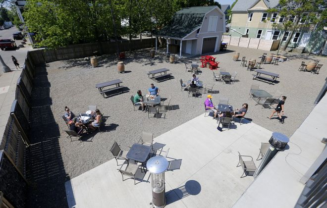 People enjoy the outside patio at the Blackthorn. Co-owner Pat Lalley and Hugger Adymy bought seven lots a few years ago and converted them into an outdoor space for the bar-restaurant. (Mark Mulville/Buffalo News)