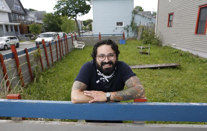 Victor Parra Gonzalez, chef and owner of Las Puertas at 385 Rhode Island St., stands in front of an over 700 square foot area that will be transformed into an outdoor seating section. He's going to call it an urban garden and plans on opening it Thursday. (Sharon Cantillon/Buffalo News)