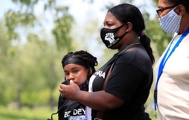 Ayanna Carr, the mother of Deyanna Davis, the woman accused of striking a state trooper with an SUV at a police brutality protest on June 1, stands with her grandaughter Tamari,10, as she speaks at a rally on Davis' behalf in MLK Park in Buffalo on Wednesday, June 10, 2020. (Harry Scull Jr./Buffalo News)
