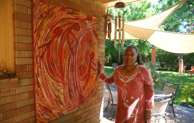"""Dawn Martin Berry-Walker added one of her paintings, """"Jazz in Motion,"""" to the patio area in her jazz-themed garden at her Buffalo home. (John Hickey/Buffalo News)"""