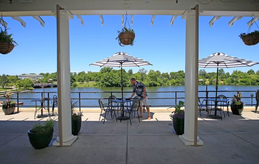 Jason Davidson owner of the Terrace at Delaware Park sets up the patio on Monday, June 15, 2020. (Harry Scull Jr./Buffalo News)