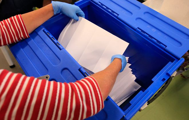 School districts across Western New York counted paper ballots after a mail-in school election that ended Tuesday. (Harry Scull Jr./Buffalo News)