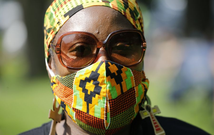 Donna Edwards of Buffalo wears a face mask from Tala's Boutique on North Parade Avenue (across from Martin Luther King Jr. Park) while attending an event in Delaware Park on June 4. (Derek Gee/Buffalo News)