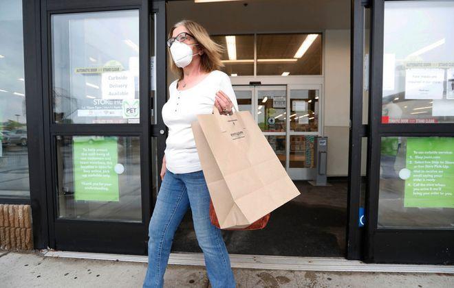 Pam Foster, of Amherst, leaves Jo-Ann Fabrics on Niagara Falls Boulevard in Amherst, Wednesday, June 3, 2020. (Sharon Cantillon/Buffalo News)