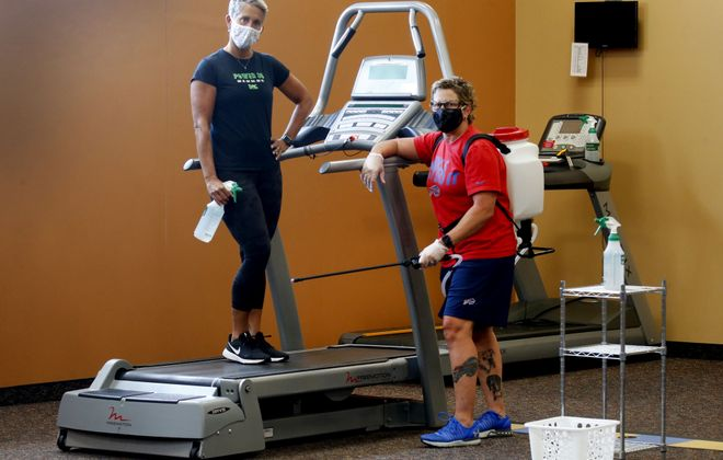 GM Connie Emerling, in red, and fitness director Debbie Hastings have taken great steps to distance work out apparatus and deployed industrial strength CDC sanitization methods and they still can't open at the BAC for Women on Eggert Road in Tonawanda. (Robert Kirkham/Buffalo News)